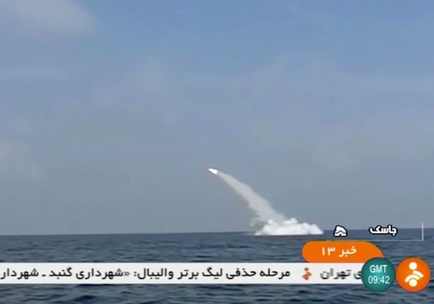 An Iranian cruise missile fires into the air from a submarine during a test at Strait of Hormuz