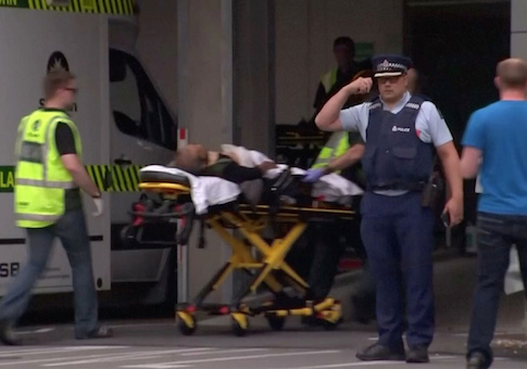 Video grab of emergency services personnel transport a stretcher carrying a person at a hospital, after reports that several shots had been fired, in central Christchurch