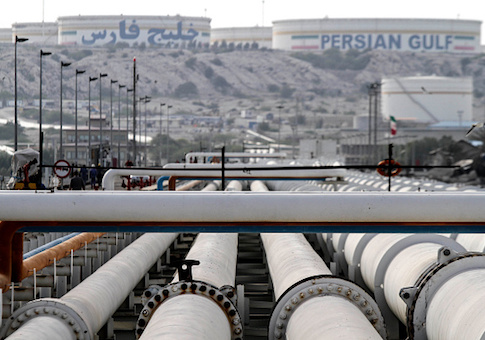 A picture shows export oil pipelines at an oil facility on the shore of the Gulf