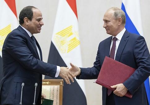 Russian President Vladimir Putin shakes hands with Egyptian President Abdel Fattah el-Sisi