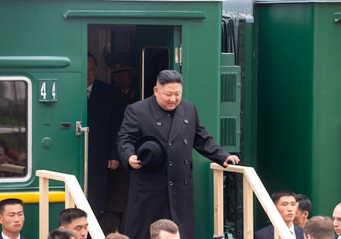 North Korean leader Kim Jong Un disembarks from a train during a welcoming ceremony at a railway station in the far eastern settlement of Khasan, Russia