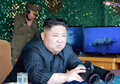 North Korea's leader Kim Jong Un supervises a 'strike drill'