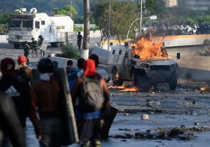 Protesters clash with security forces in Caracas