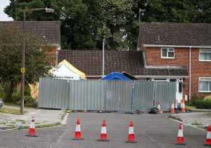 A barrier and a police tent stand outside Sergei Skripal's home in Salisbury, Britain