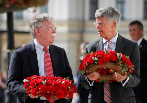 U.S. National Security Adviser John Bolton and U.S. Embassy Charge d'Affairs William Taylor attend a wreath-laying ceremony at the memorial for soldiers killed in a recent conflict in eastern Ukraine