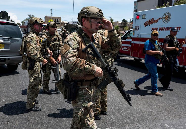 Law enforcement agencies respond to an active shooter at a Wal-Mart near Cielo Vista Mall in El Paso, Texas
