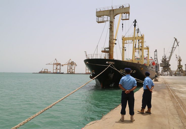 Yemeni coast guards look on at Saleef port in the western Red Sea Hodeida province