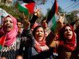 Palestinian women shout anti-Israeli slogans during a rally