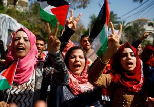 Palestinian women shout anti-Israeli slogans during a rally
