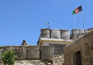 An advisor from the 2nd Security Force Assistance Brigade stands at the fortification of a base during deployment to Afghanistan