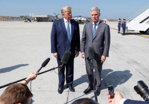 U.S. President Donald Trump faces reporters with U.S. hostage negotiator Robert O'Brien