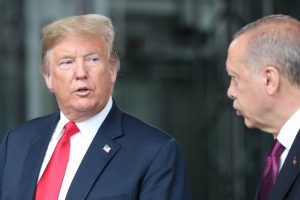 President Donald Trump talks to Turkey's President Recep Tayyip Erdogan at NATO headquarters in Brussels
