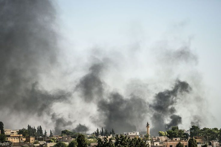 A picture taken in Akcakale at the Turkish border with Syria shows smokes rising from the Syrian town of Tal Abyad