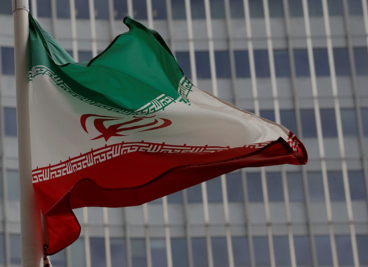 FILE PHOTO: An Iranian flag flutters in front of the IAEA headquarters in Vienna