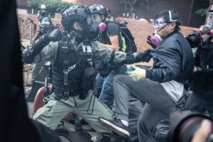 Police arrest anti-government protesters at Hong Kong Polytechnic University