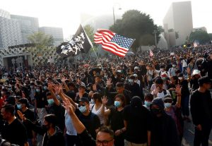 "Anti-government protesters raise their hands as they attend the ""Lest We Forget"" rally in Hong Kong"