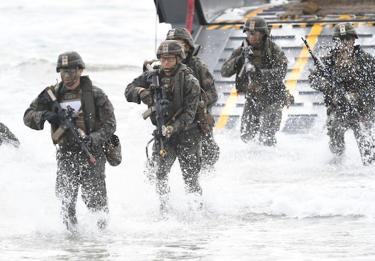 U.S Marines can be seen disembarking form a landing craft as part of an amphibious landing on July 22, 2019 in Bowen, Australia
