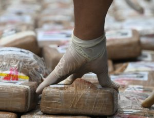 Authorities incinerate a load of cocaine seized to two Colombian nationals navigating along the Caribbean, in Tegucigalpa, on July 11, 2017. / AFP PHOTO / ORLANDO SIERRA (Photo credit should read ORLANDO SIERRA/AFP via Getty Images)