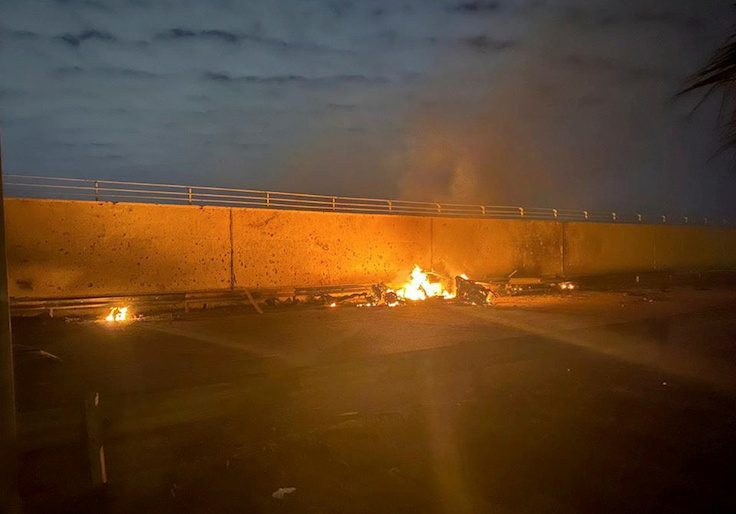 Burning debris are seen on a road near Baghdad International Airport, which according to Iraqi paramilitary groups were caused by three rockets hitting the airport in Iraq