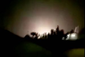An explosion is seen following missiles landing at what is believed to be Ain al-Asad Air Base in Iraq