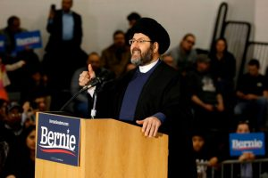 Imam Al-Hasan Qazwini from the Islamic Institute of America, speaks during a campaign rally for Democratic presidential hopeful Bernie Sanders