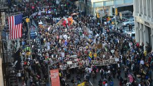 Occupy Wall Street participants stage a march down Broadway