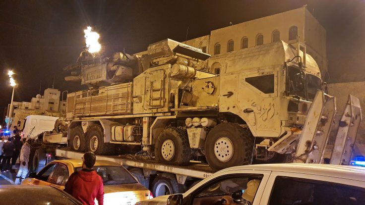 Forces loyal to Libya's UN-recognized GNA parade a Russian-made Pantsir air defense system truck