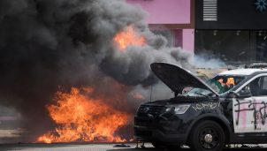 Police vehicles burn