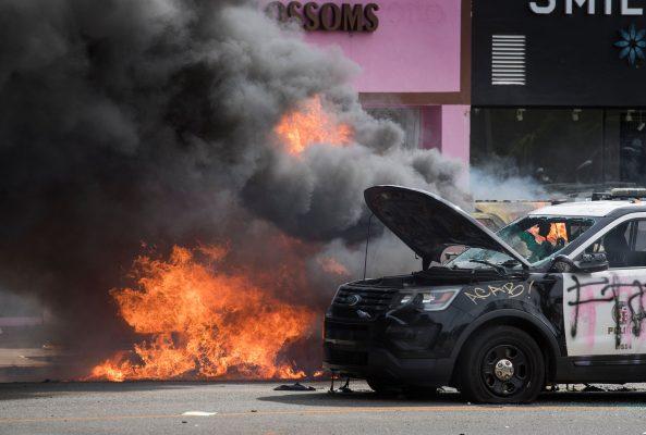 Police vehicles burn
