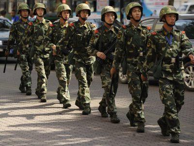 Chinese paramilatary police patrol on a street in Urumqi, capital of China's Xinjiang region