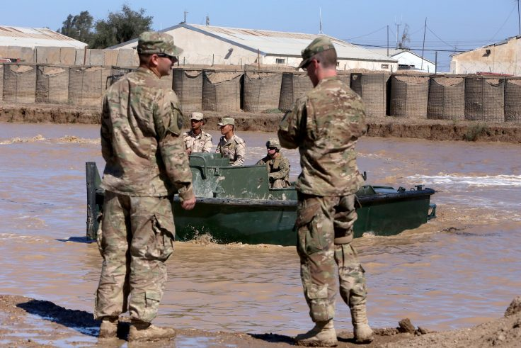 U.S. army forces supervise during a training session at the Taji camp, north of Baghdad in 2017