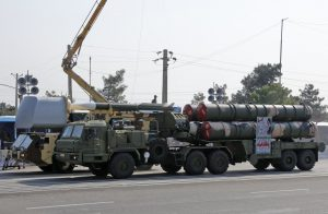 An Iranian military truck carries parts of a S-300 air defense missile system during a parade