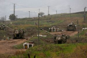 Israeli self-propelled howitzers are positioned in the Israeli-annexed Golan Heights on the border with Syria