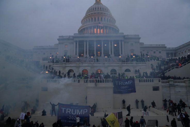 Police officers stand guard as supporters of U.S. President Donald Trump gather in front of the U.S. Capitol building