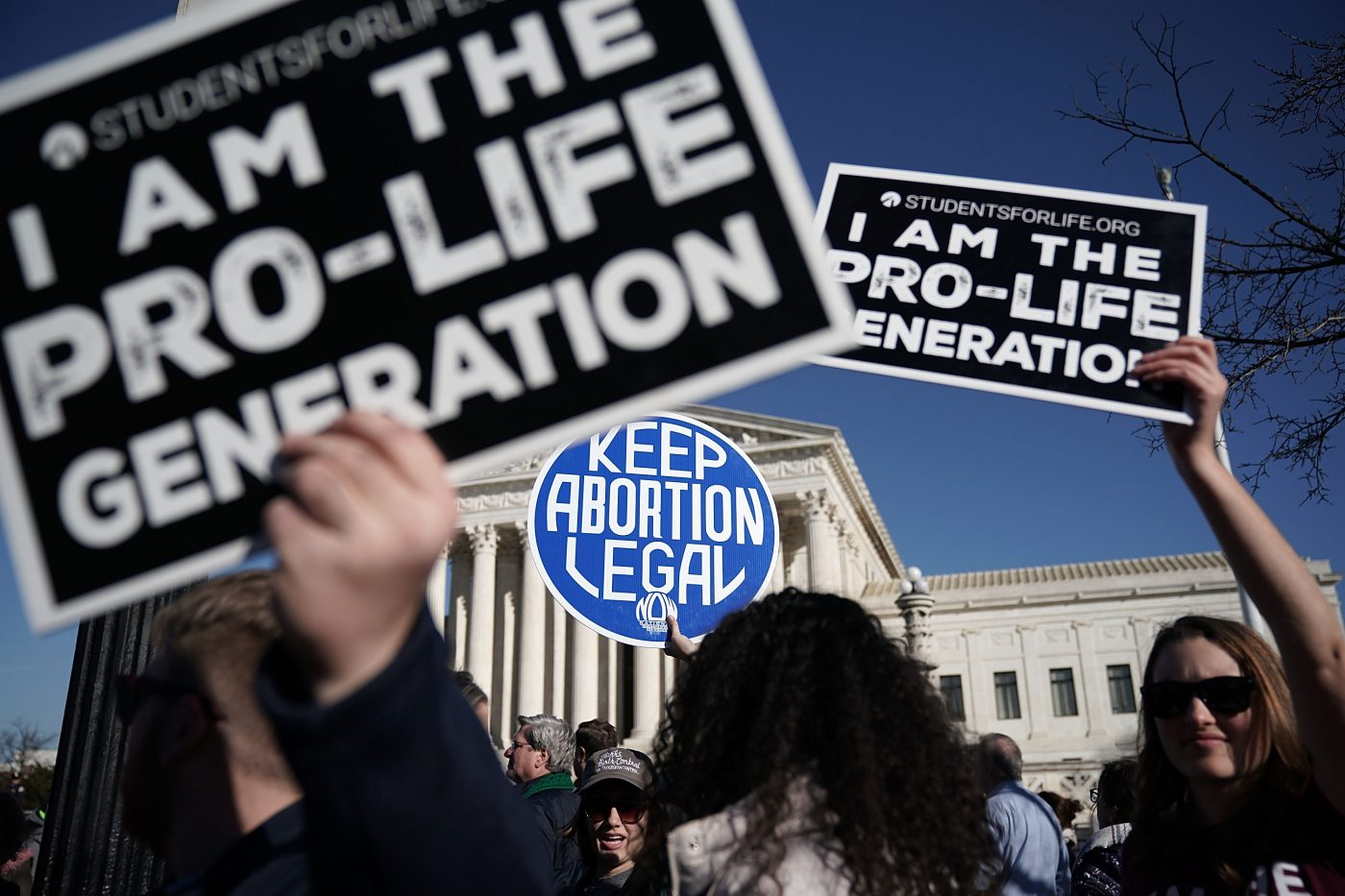 A group of scientists is urging the Supreme Court to uphold a crucial abortion restriction