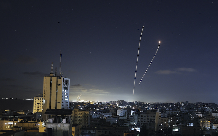 A streak of light appears as Israel's Iron Dome anti-missile system intercepts rockets launched from the Gaza Strip