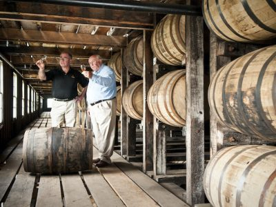 Eddie Russell and his father Jimmy sample bourbon inside Wild Turkey's rickhouse in Lawrenceburg, Ky.